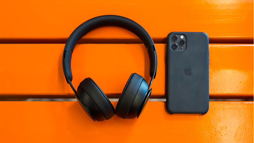 Beats Solo Pro next to iPhone