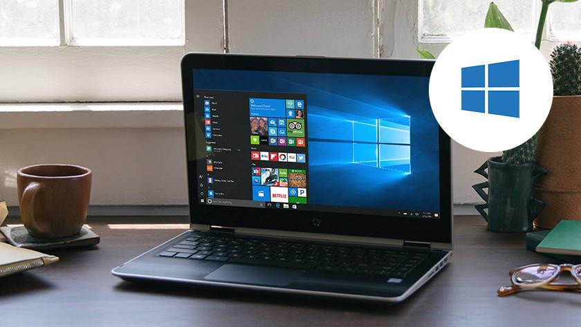 Windows laptop on desk. Windows logo in the corner.