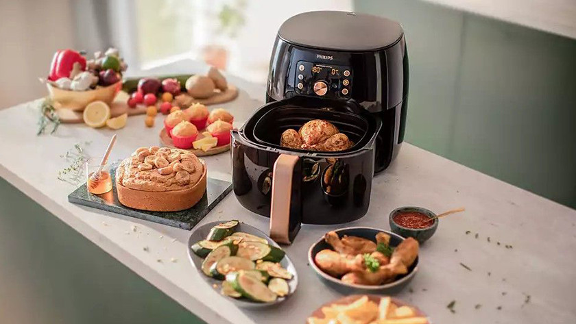 Airfryer with vegetables, pie, meat, fries