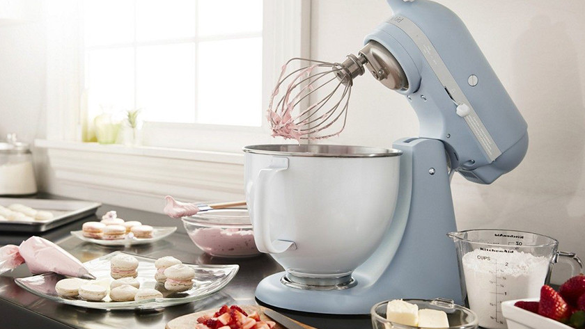 Light blue KitchenAid stand mixer with macarons
