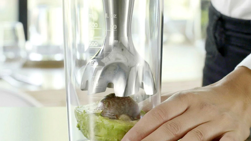 Immersion blender mixes avocado with seed