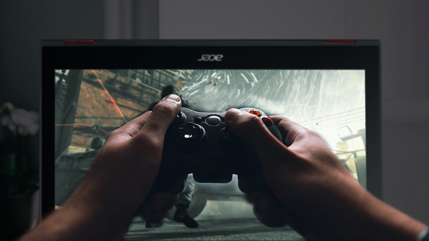 Acer Nitro gaming laptop with controller.