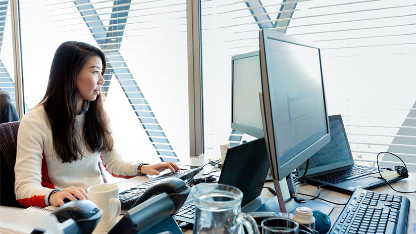 Woman working behind a PC in the office.