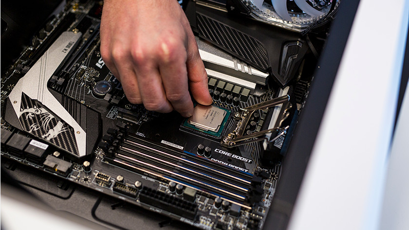 Man installing processor in motherboard