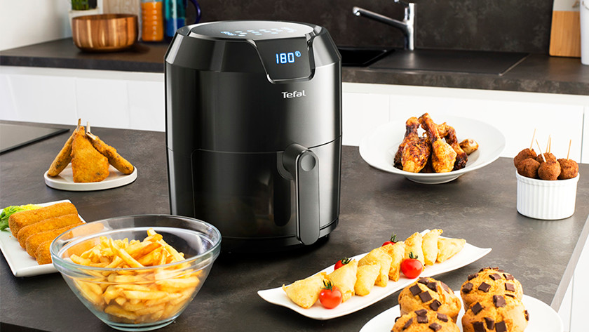 Airfryer with fries, chicken, and other snacks