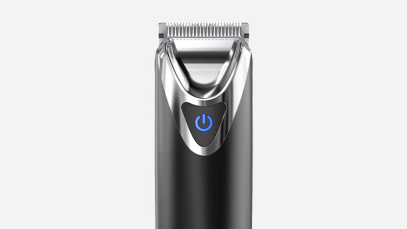 Beard trimmer with fixed comb attachment