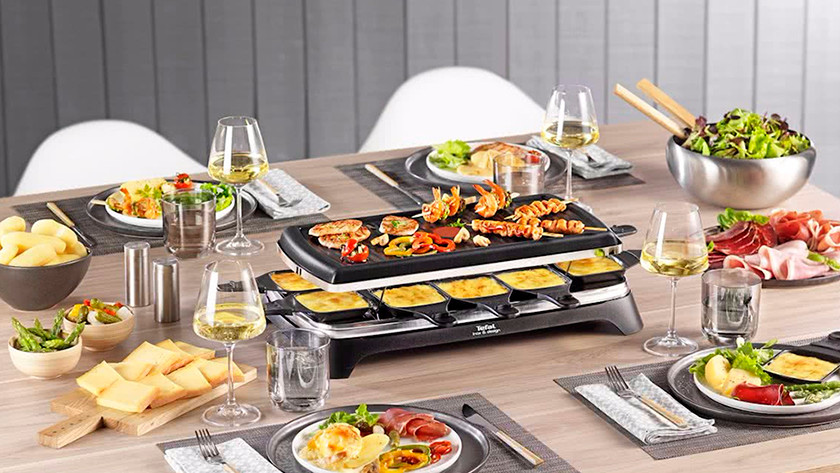 Set table with raclette grill with food