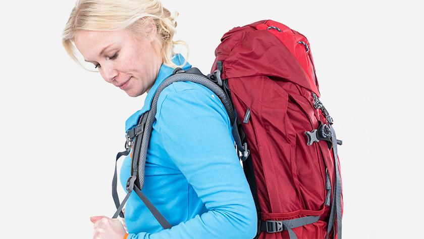 Adjust shoulder straps on backpack