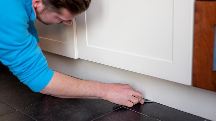 Remove baseboard dishwasher