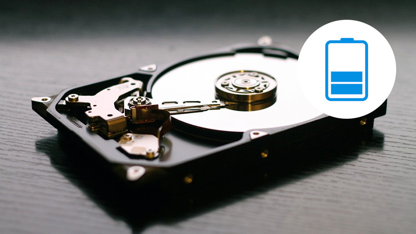 A hard drive (HDD) with half empty battery icon.