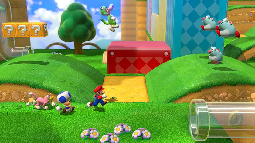 Mario, Toad en Princess Peach in roze kattenpak rennen door een Super Mario 3D World level richting een glazen pijp.