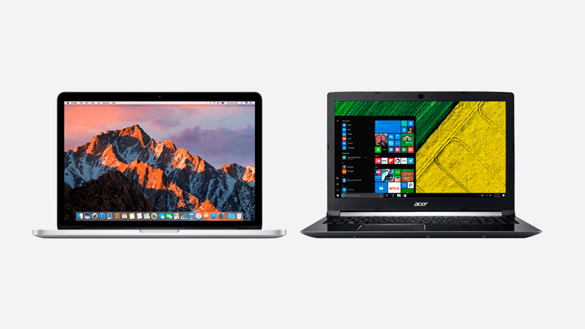 A MacBook and a laptop side by side.