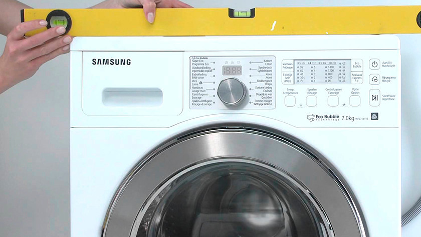 Wasmachine waterpas zetten