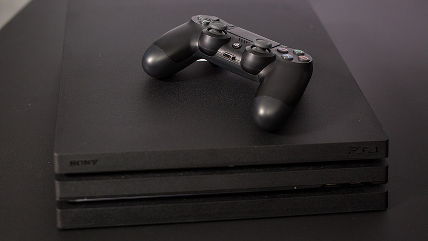 PlayStation 4 console with controller.