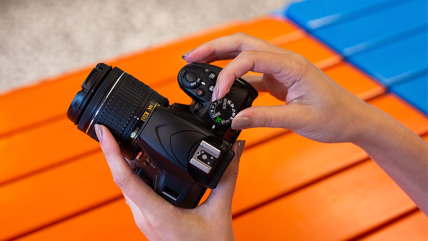 Camera aanzetten en modus kiezen