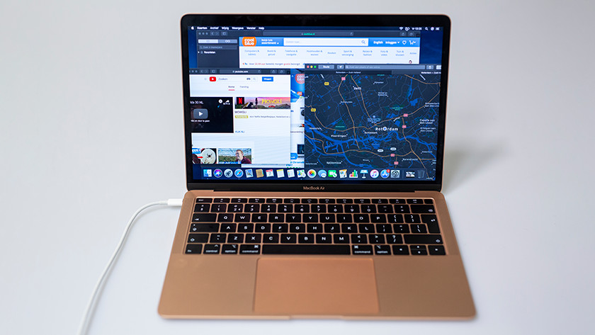 A MacBook Air with different programs open.