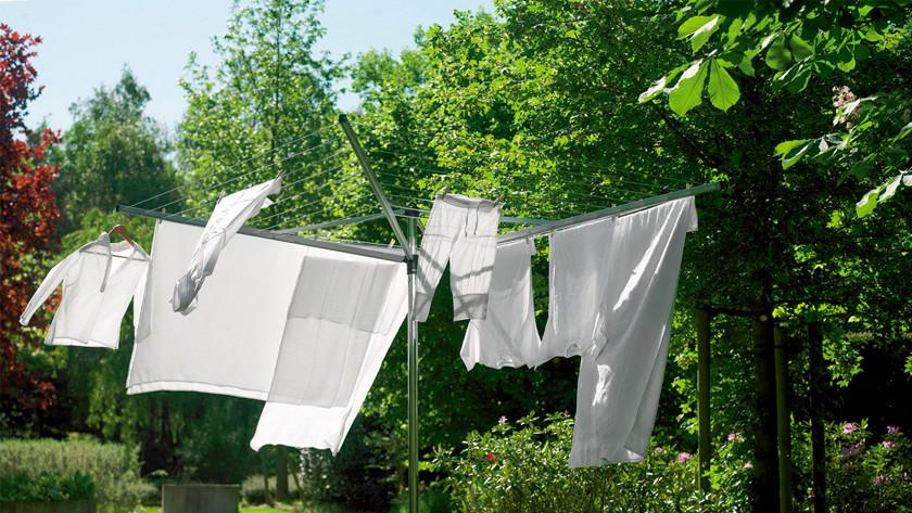 Umbrella drying rack with laundry