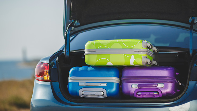 Traveling by car hard suitcase