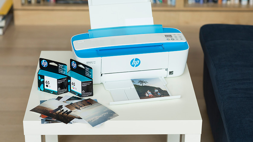 HP inkjet printer with cartridges on a table
