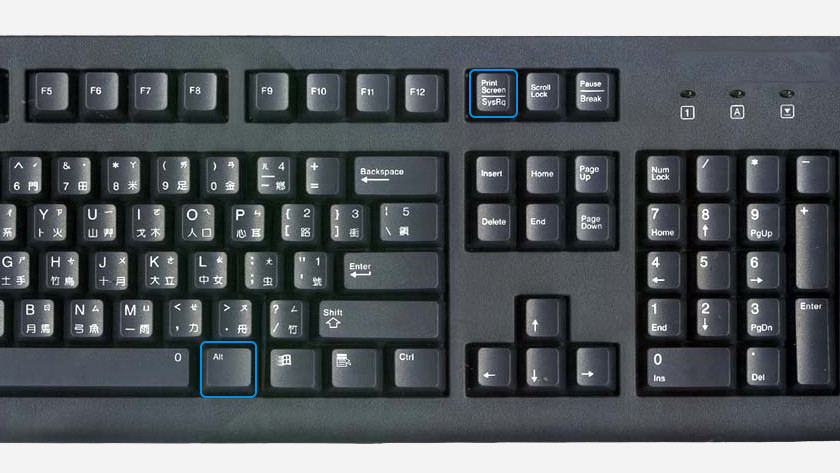 The alt button and screenshot button highlighted on a keyboard.