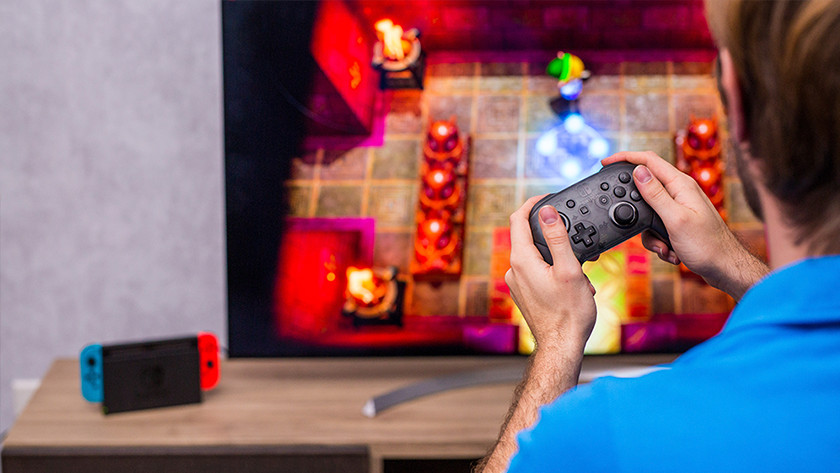 Playing Zelda Link's Awakening on the Nintendo Switch with a Pro Controller.