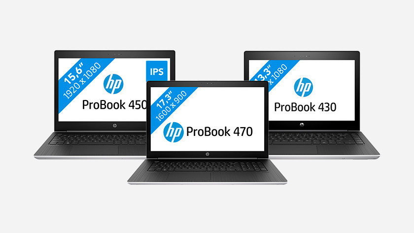 Three HP ProBook laptops.
