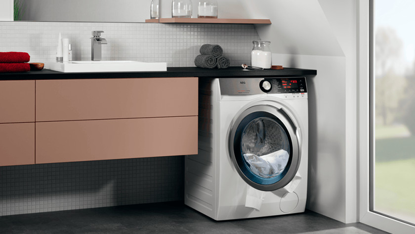 Washer dryer combination in bathroom