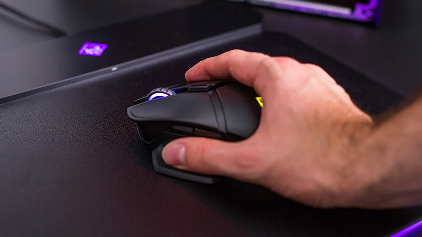 Male hand on HP Omen gaming mouse.
