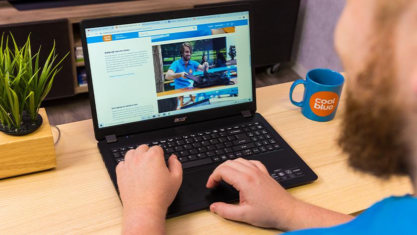 Man works on Acer laptop.