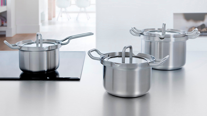 Different sizes of pans with lids in the kitchen