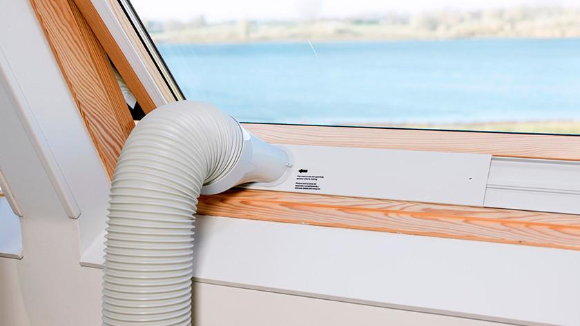 Drain hose portable air conditioner through window