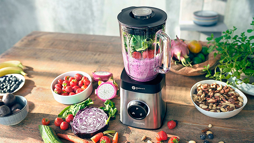 Philips blender filled with vegetables, fruit, and nuts