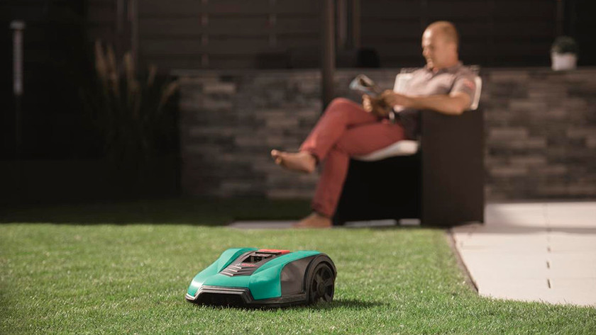 Robot lawn mower in garden