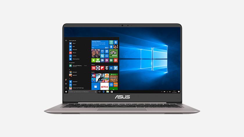 Asus laptop with Windows 10 start menu on screen.
