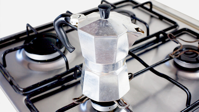 Making coffee with an espresso pot