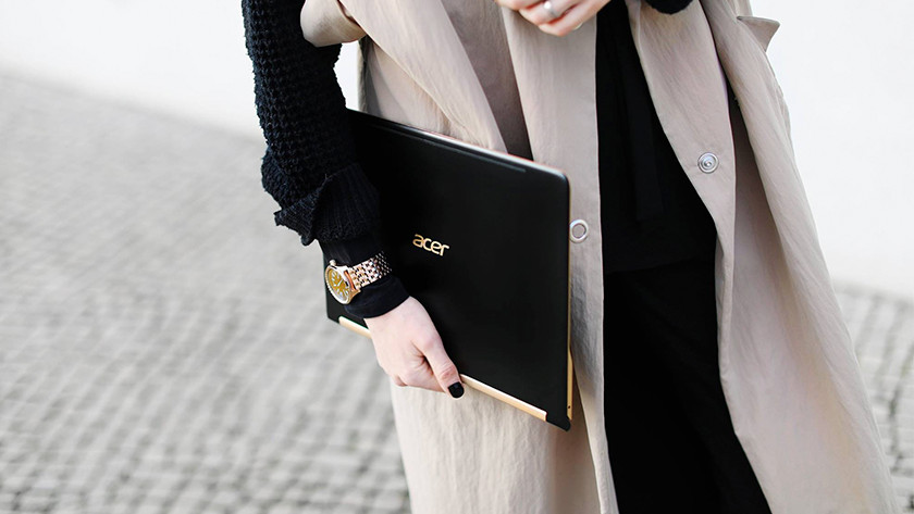 Woman carries Swift 7 laptop under her arm.