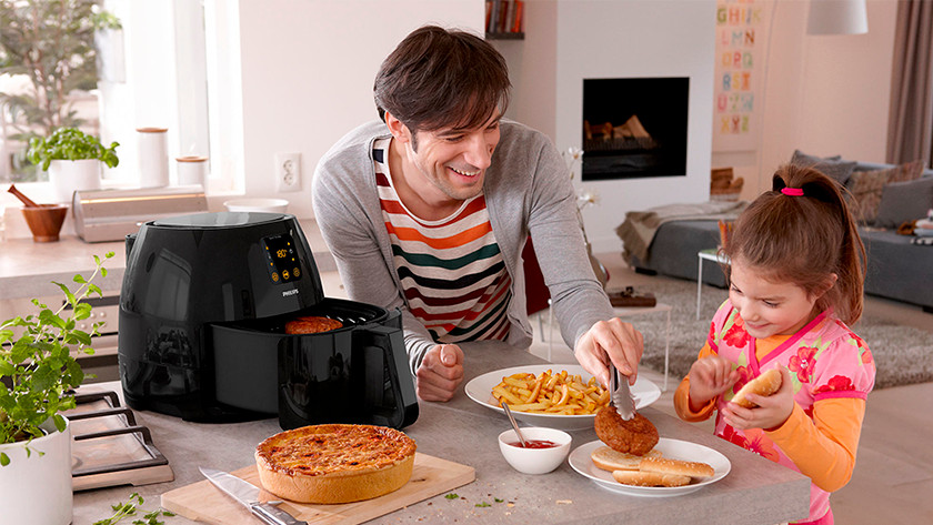 Airfryer with fries, meat, and quiche