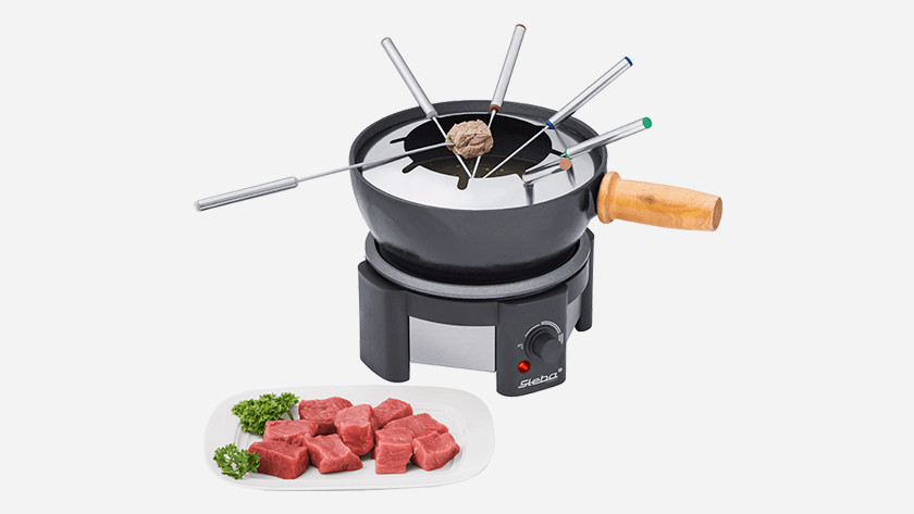 Fondue set with broth and meat
