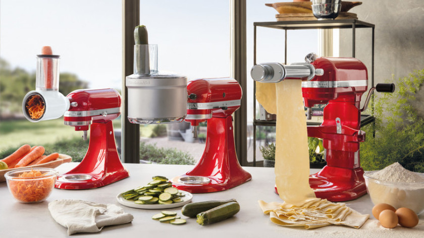 KitchenAid stand mixers with grater, slicer, and pasta roller attachment.