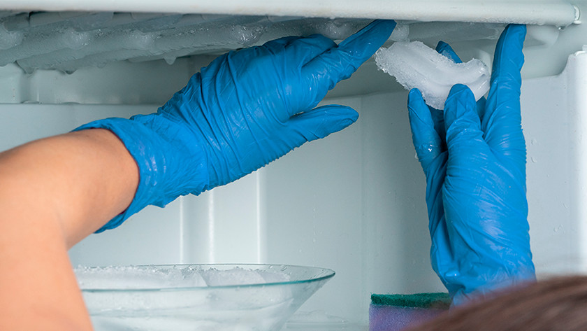 Remove ice from freezer compartment