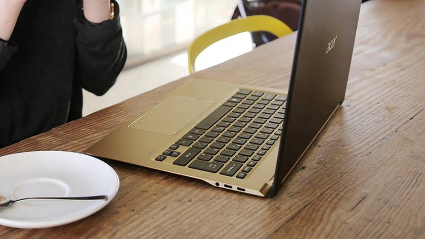 Woman works on Acer Swift 7 behind a desk.