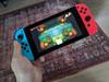 Nintendo Switch (2019 Upgrade) Rood/Blauw + Bigben Nintendo Switch Travel Case Zwart (Afbeelding 1 van 4)