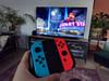 Nintendo Switch (2019 Upgrade) Rood/Blauw + Bigben Nintendo Switch Travel Case Zwart (Afbeelding 3 van 4)